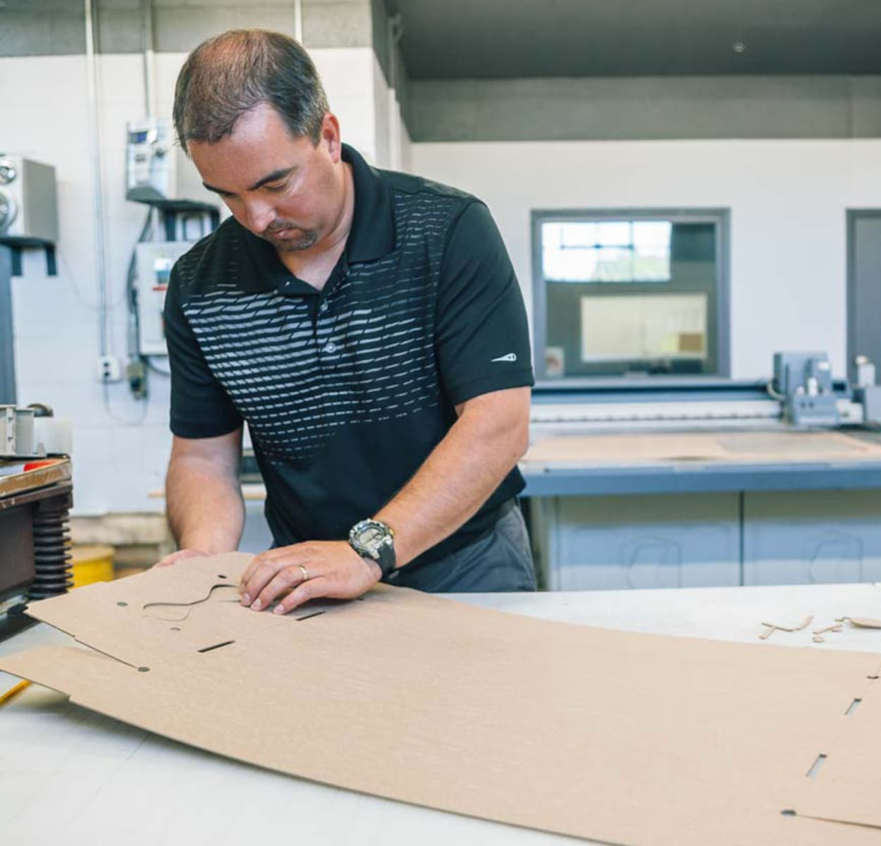 Employee working on paperboard